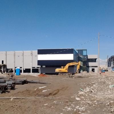 Colocación de cempanel y aluminio en Fachadas,  cocheras y edificio administrativo del tren interurbano México-Toluca.