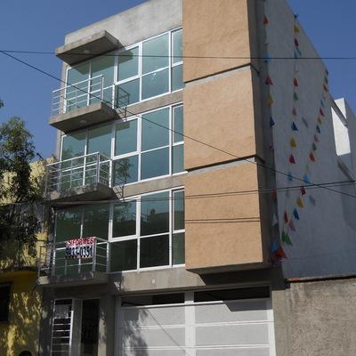 Fachada De Edificio De Depártamentos En La Calle De Santa Marta En Lacolonia Molino De Santo Domingo