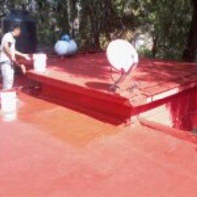 Impermeabilizacion en acrilico color terracota (rojo) con maya reforzada