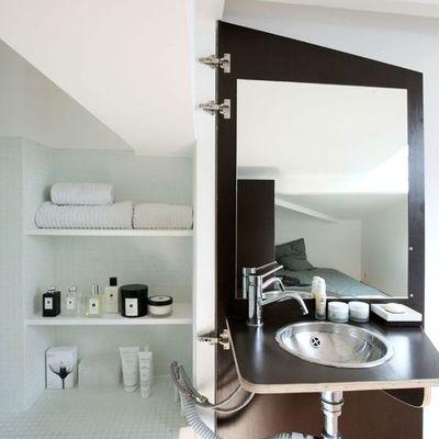baño con estructura retráctil