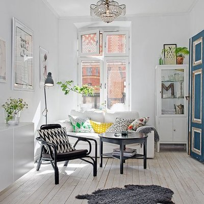 Sala estilo escandinavo con piso radiante