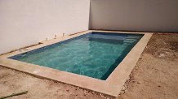 Foto piscina 6 x 4 con acabado diamond brite y veneciano for Piscina sauces 6