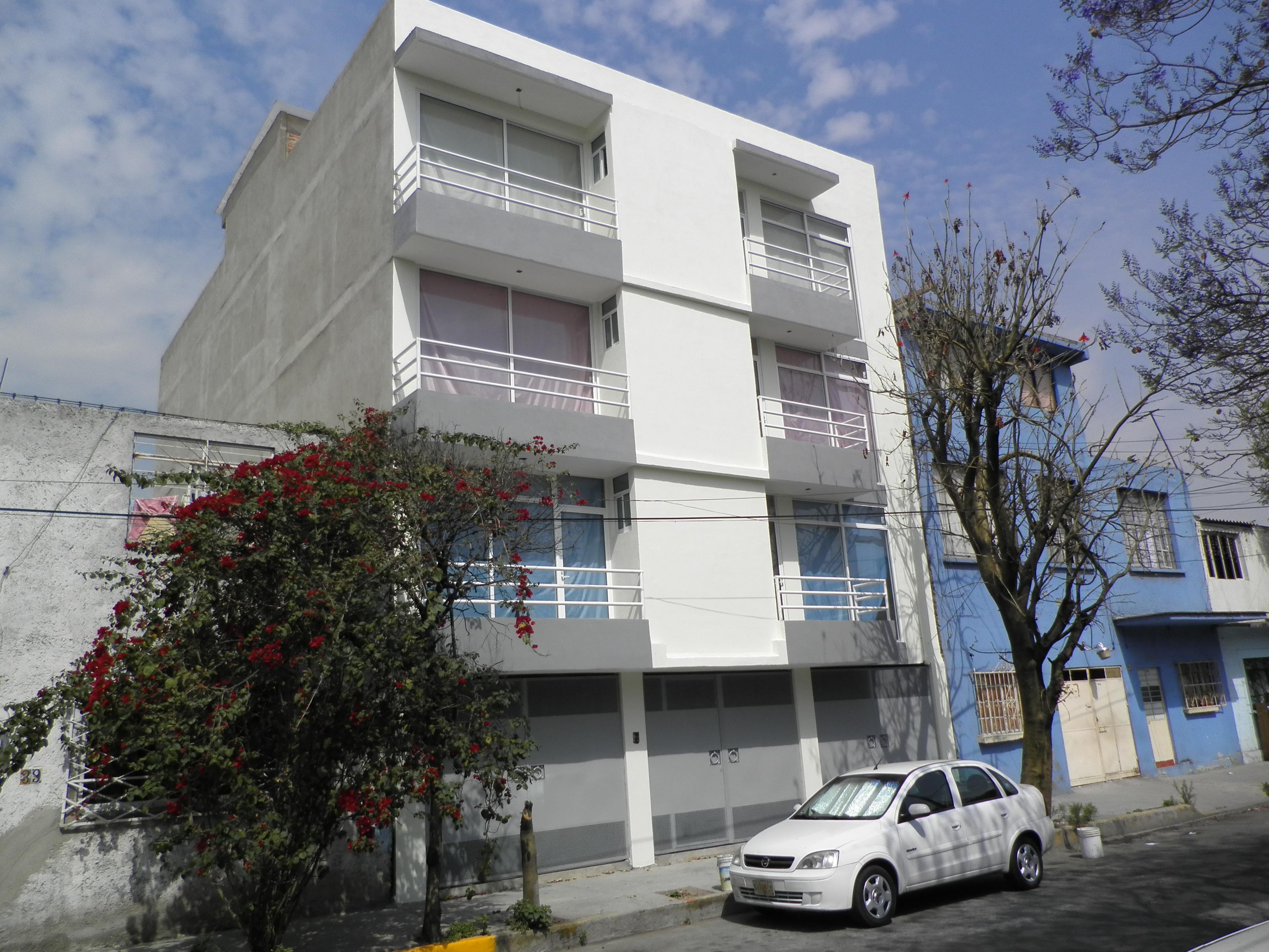Construccion de un edificio de 4 niveles para 3 for Edificios minimalistas fotos