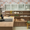 cucina-febal-industrial-con-mensole-e-tavola-a-penisola