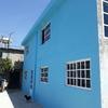 Lijar y pintar 60 metros de madera de piso exterior.