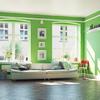 Sala con paredes pintadas de color verde Greenery