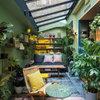 Terraza cerrada con techo de vidrio