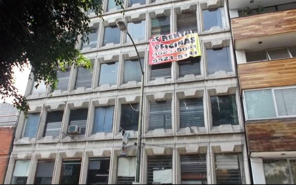 ¿Cuánto cuesta la limpieza de vidrios exteriores de un edificio como el de la imagen?