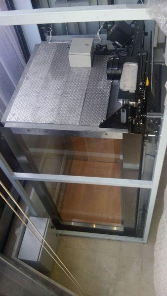 ¿Cuál es el costo de un elevador residencial de 2.40m de altura?