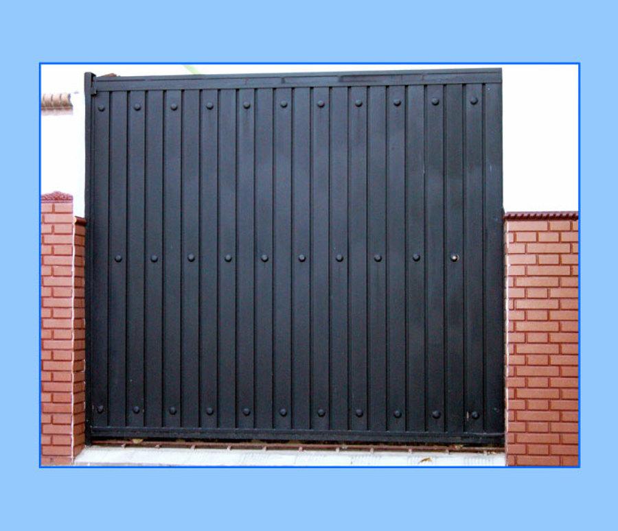 Proveer puerta principal para exterior edificio 1 84 de for Garajes modelos
