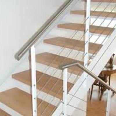 Huellas de madera para escalera y barandal de metal y madera ...