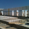 Aplanar muro de panel con lanzadora de mortero industrial, 2000 m2 con lanzadora industrial.