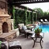 Barda piscina y jardín con chimenea